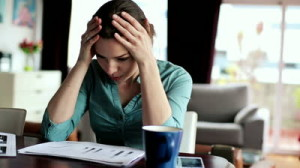 stock-footage-overwhelmed-sad-businesswoman-reading-documents-in-home